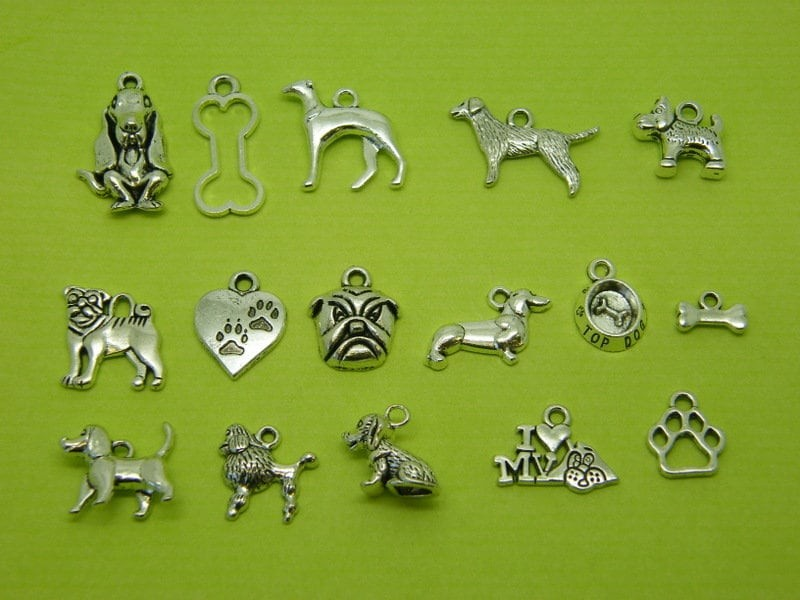 The Dog Collection - 16 different antique silver tone charms
