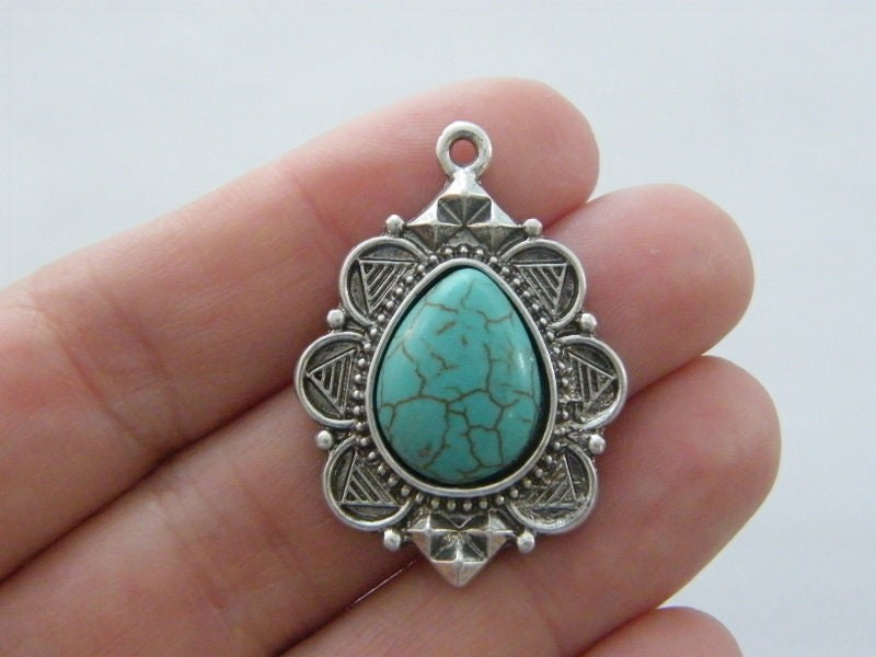 1 Oval blue pendant antique silver tone M603