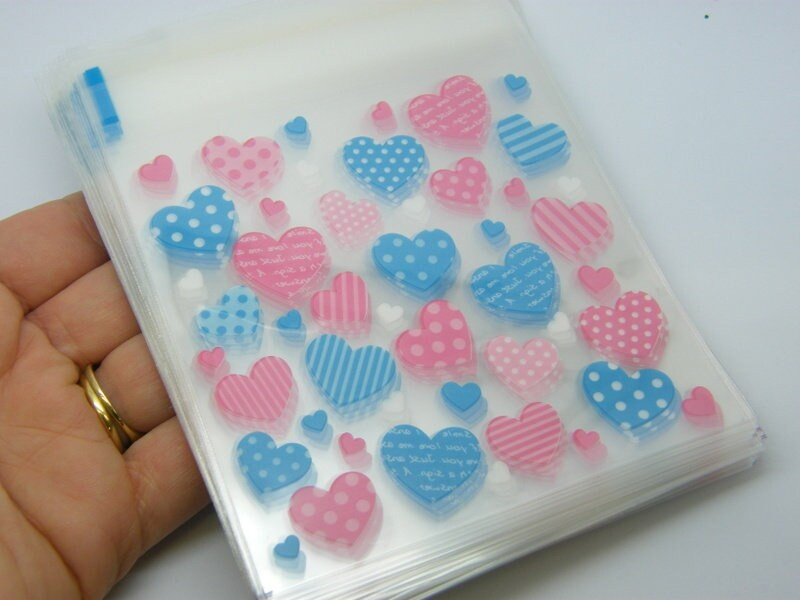 96 Plastic bags packets hearts pink blue self sealing 10 x 10cm