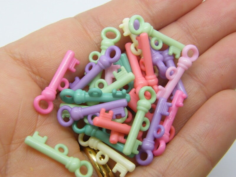 100 Key charms random mixed acrylic K57