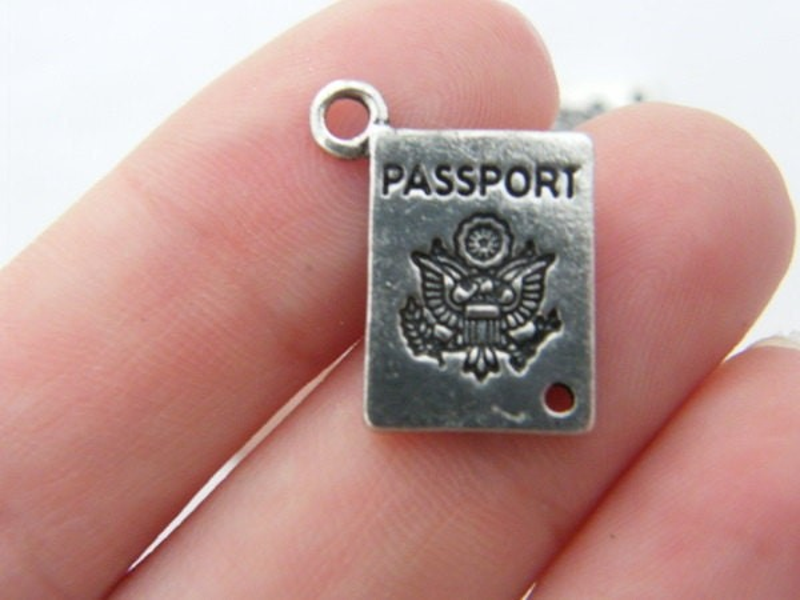 8 Passport charms or connectors antique silver tone WT55