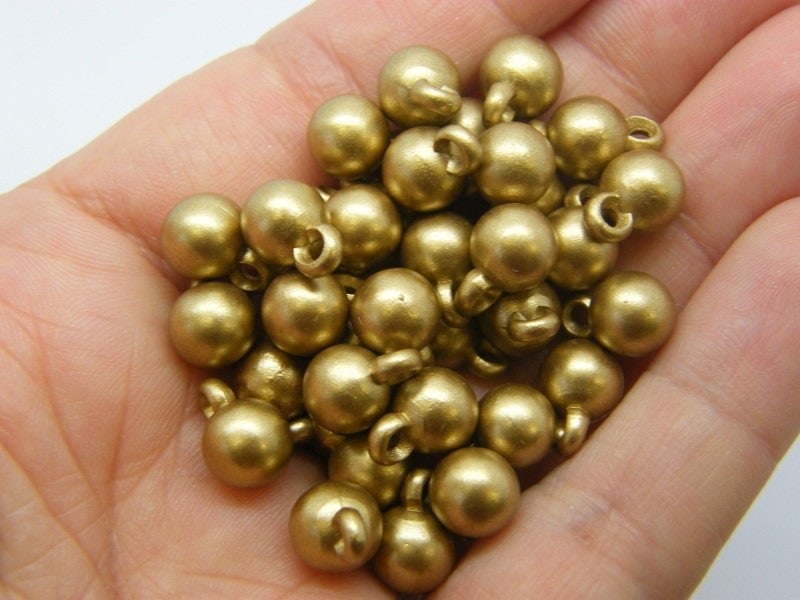 100 Round charms spray painted gold acrylic M613