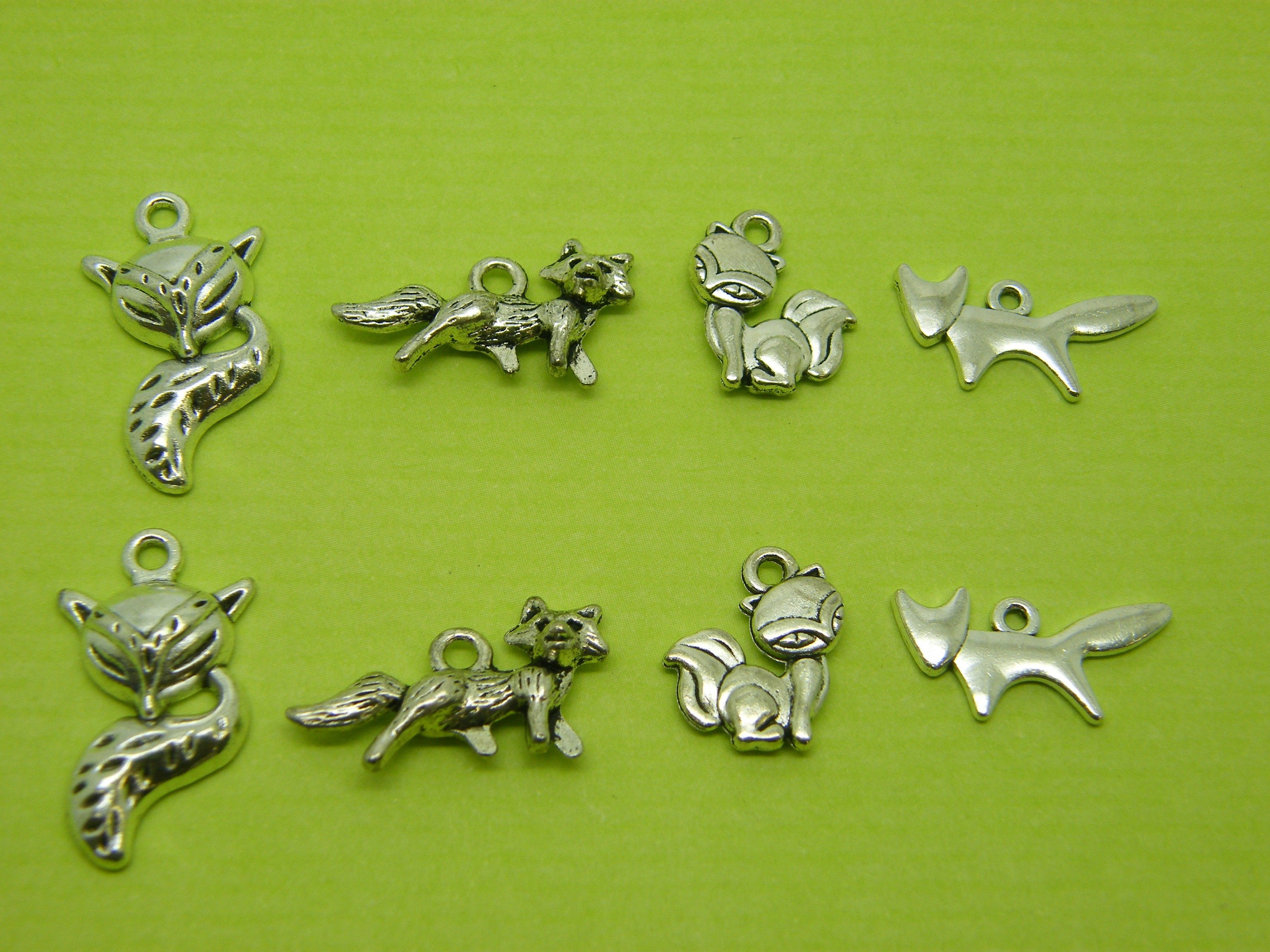 The Fox Collection - 8 antique silver tone charms