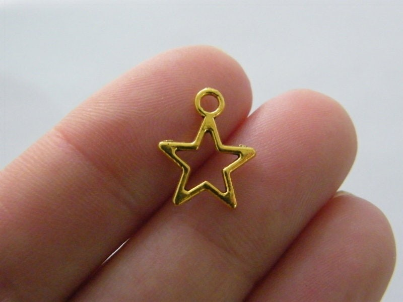 14 Star charms  antique gold tone S96