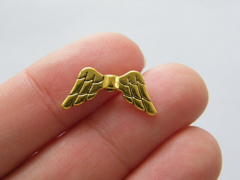 12 Angel wing spacer beads antique gold tone AW11