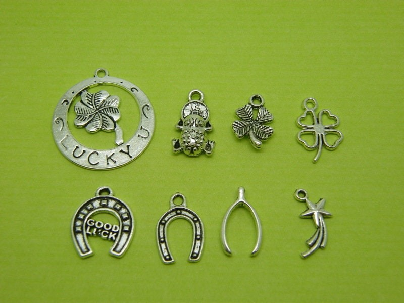 The Good Luck Collection - 8 different antique silver tone charms