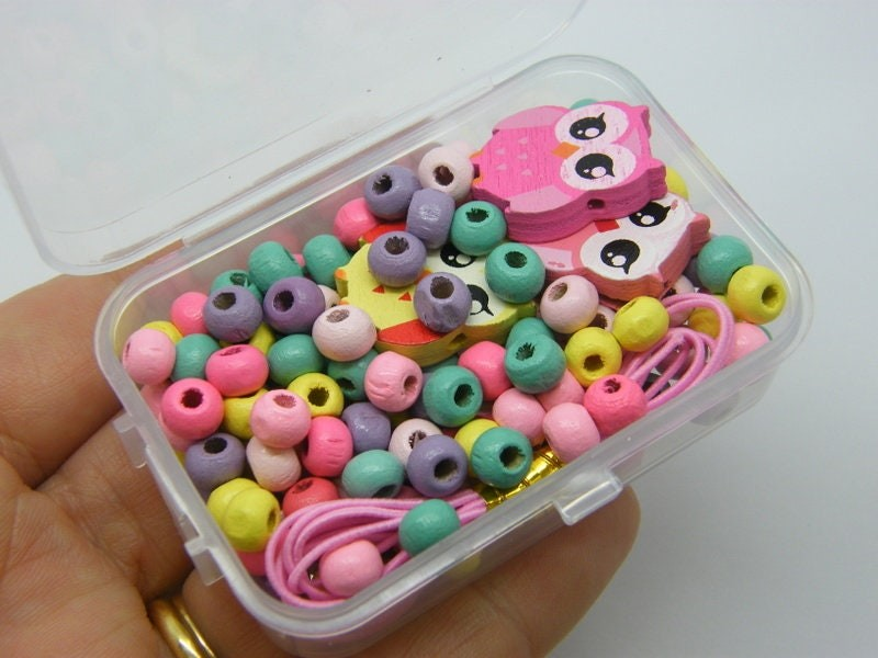 1 Box owl and assorted spacer beads wood