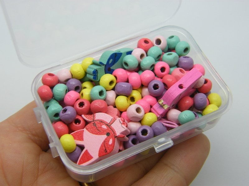 1 Box fox and assorted spacer beads wood