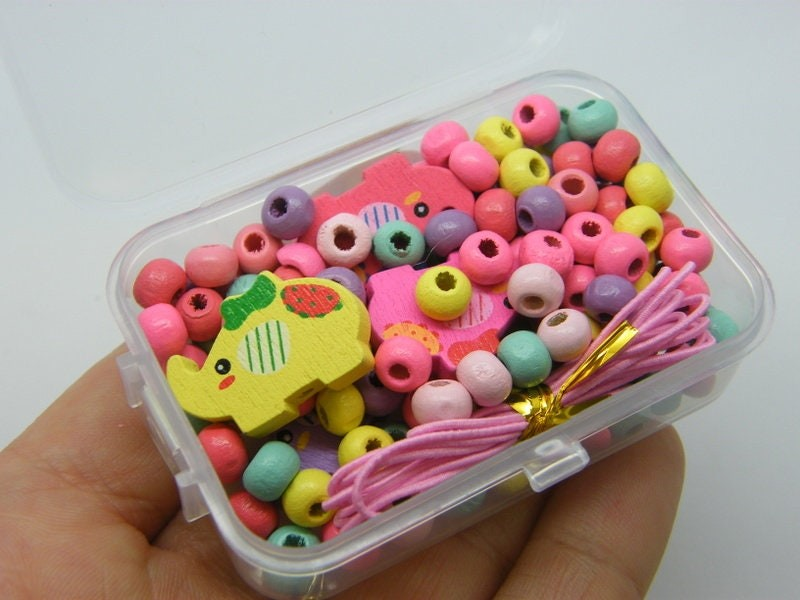 1 Box elephant and assorted spacer beads wood