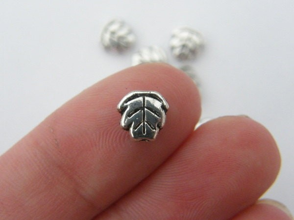 14 Leaf spacer beads antique silver tone L31