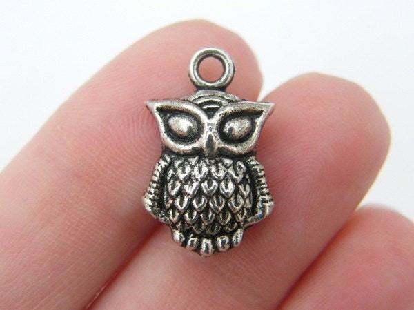 8 Owl charms antique silver tone B293