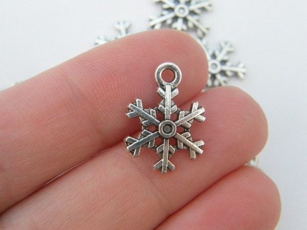 10 Snowflake Christmas charms antique silver tone SF1