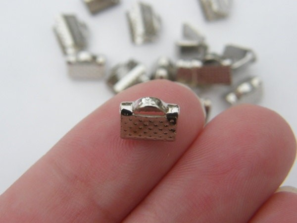 30 Ribbon crimps 8 x 6mm silver tone FS383