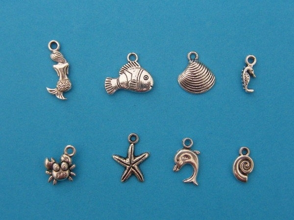 The Mermaid Collection - 8 different antique silver tone charms