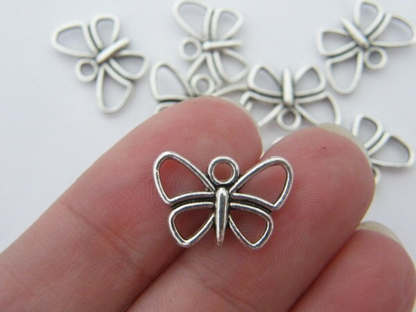 10 Butterfly charms tibetan silver A335