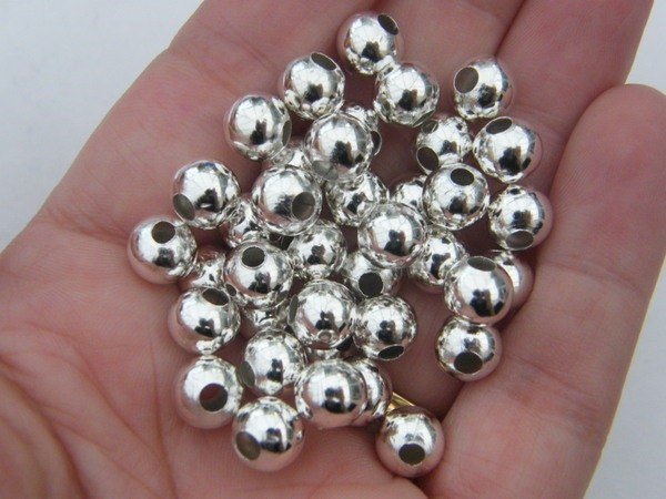 BULK 50 Spacer beads 8mm silver plated FS403