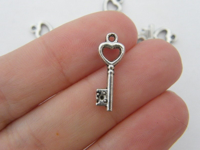 10 Key charms antique silver tone K1