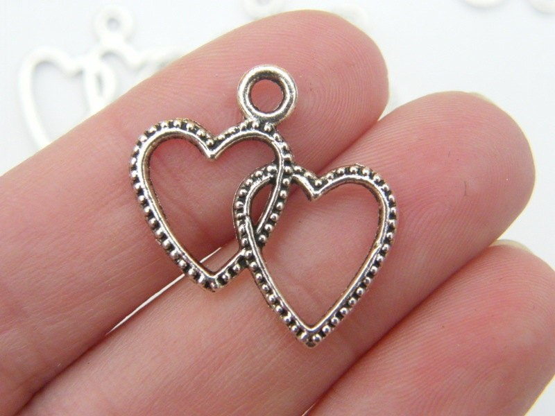 10 Double heart pendants antique silver tone H92