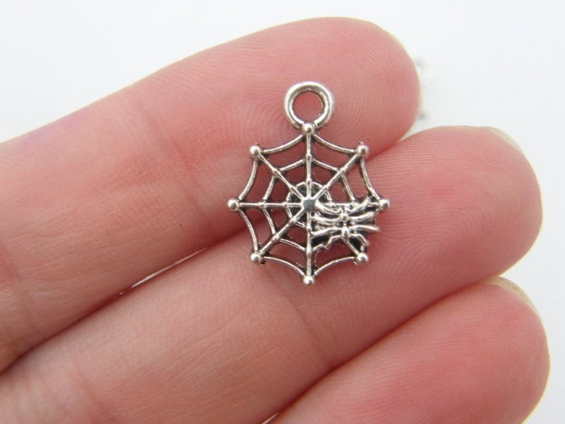 10 spider in a spiderweb charms tibetan silver HC124