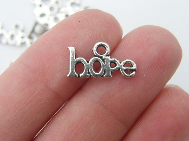 18 Hope charms antique silver tone M247