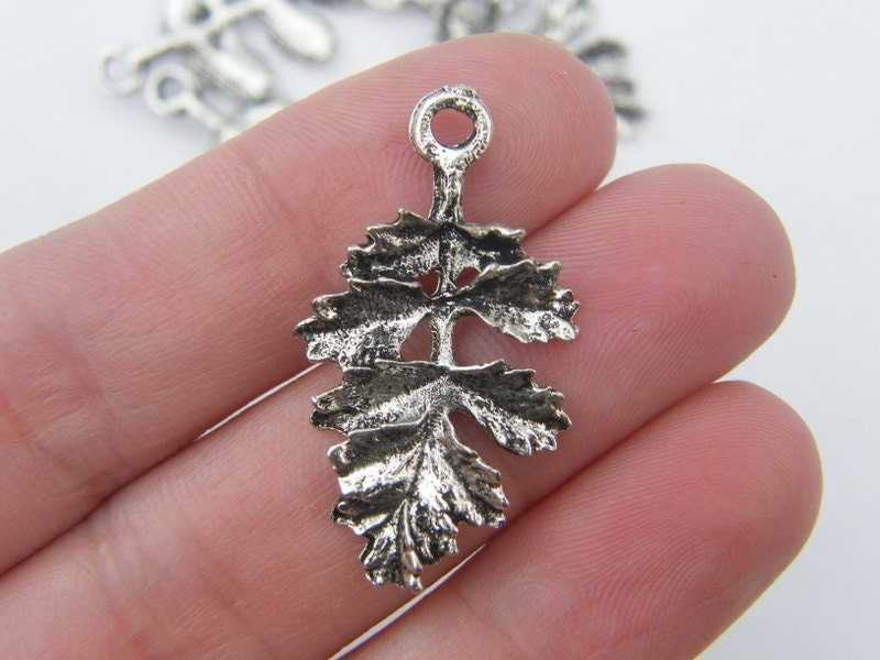 6 Leaf pendants antique silver tone L57