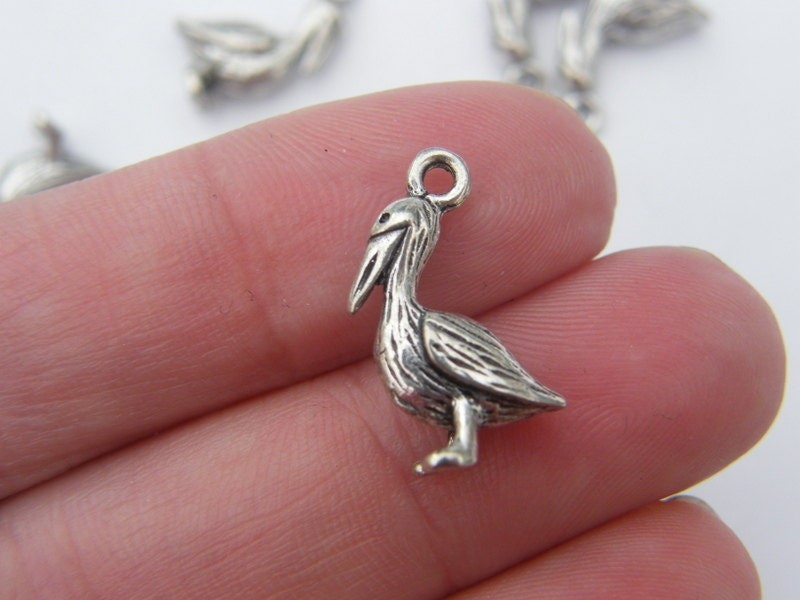 6 Pelican charms antique silver tone B87