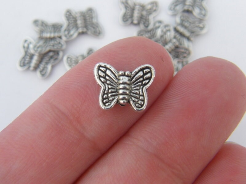 14 Butterfly spacer beads antique silver tone A338
