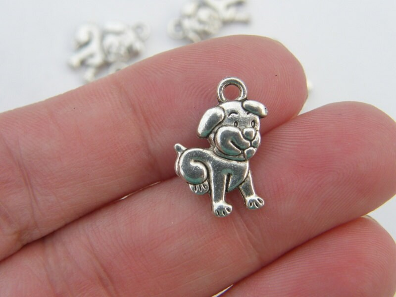 8 Dog charms ibetan silver A886