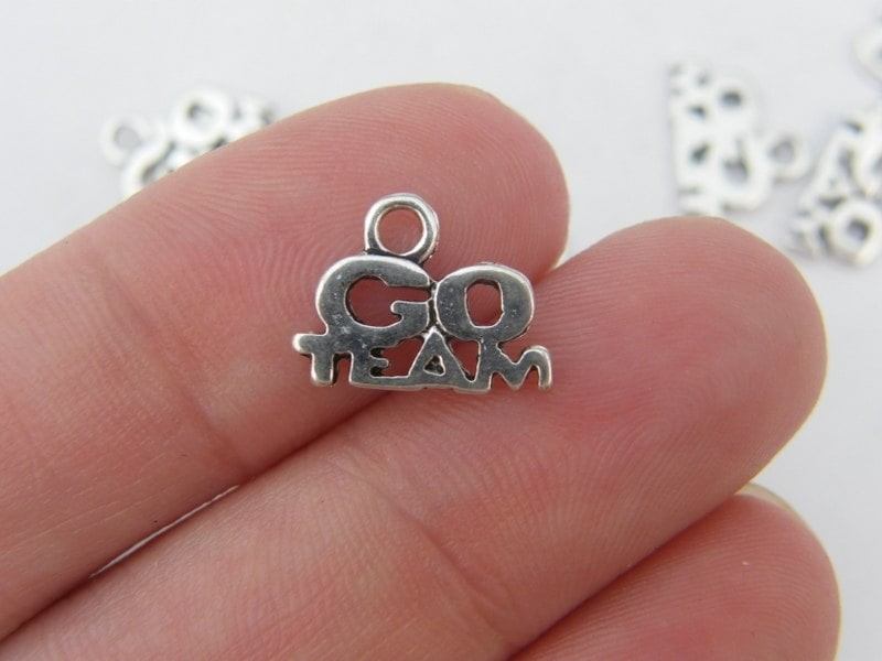 10 Go Team charms antique silver tone SP90