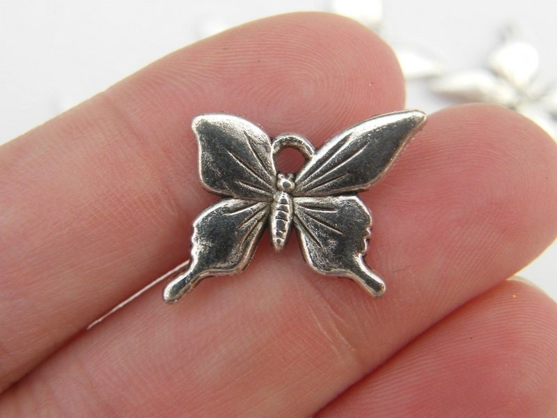 8 Butterfly charms antique silver tone A325