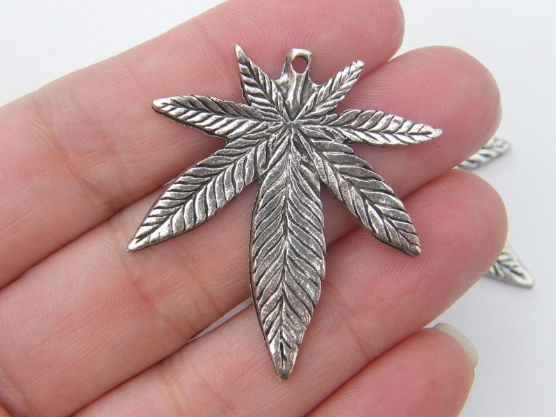 4 Marijuana weed leaf charms antique silver tone L23