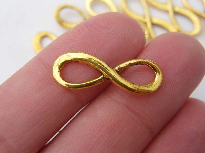 12 Infinity charms or connectors antique gold tone GC204