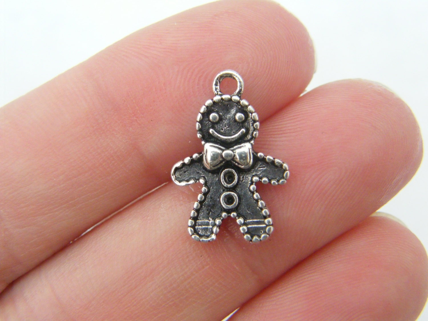 BULK 50 Gingerbread man charms antique silver tone CT81