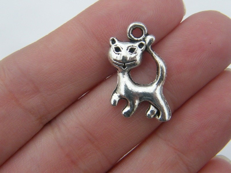 8 Cat charms antique silver tone A874