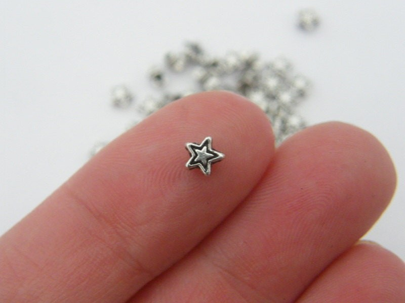 100 Star  spacer beads antique silver tone S22