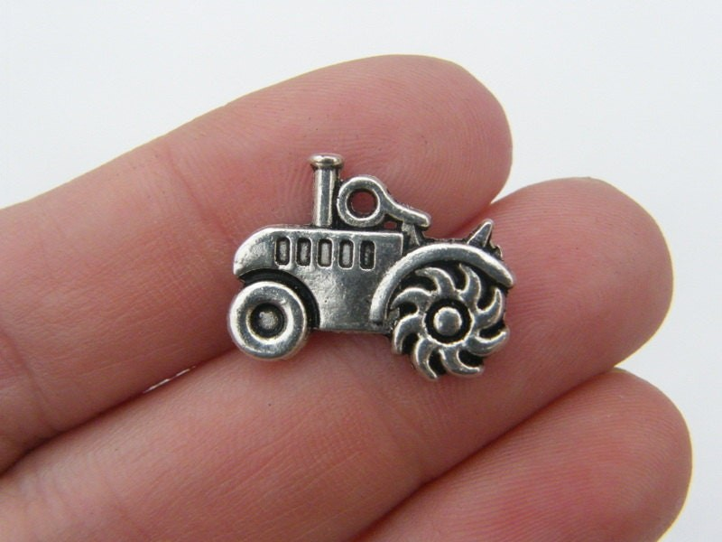 BULK 50 Tractor charms antique silver tone TT3