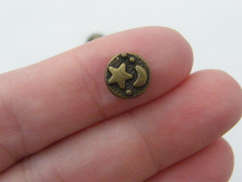 16 Star and moon spacer bead antique bronze tone S266