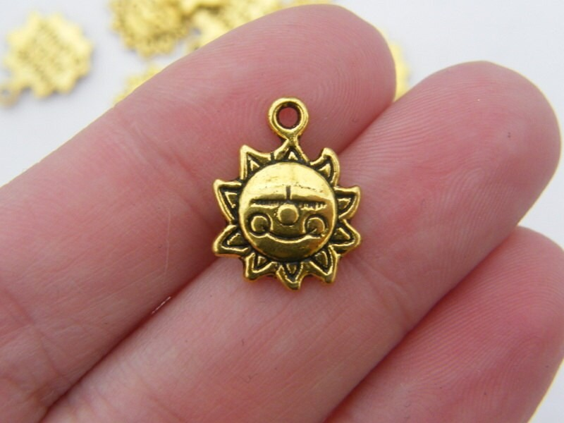 10 Sun charms antique gold tone GC97