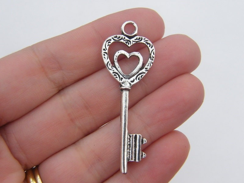 4 Key pendants antique silver tone K43