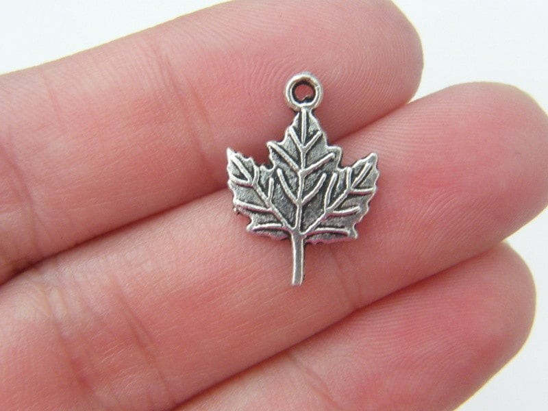 14 Leaf charms antique silver tone L26