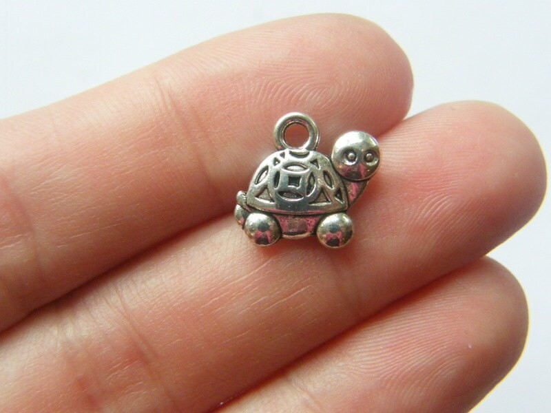 8  Tortoise charms antique silver tone FF137