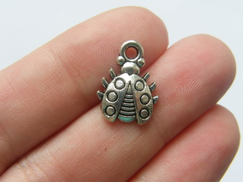 10 Ladybug charms antique silver tone A130