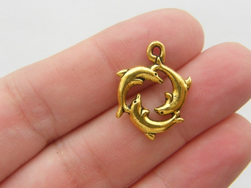 8 Dolphin charms antique gold tone GC5