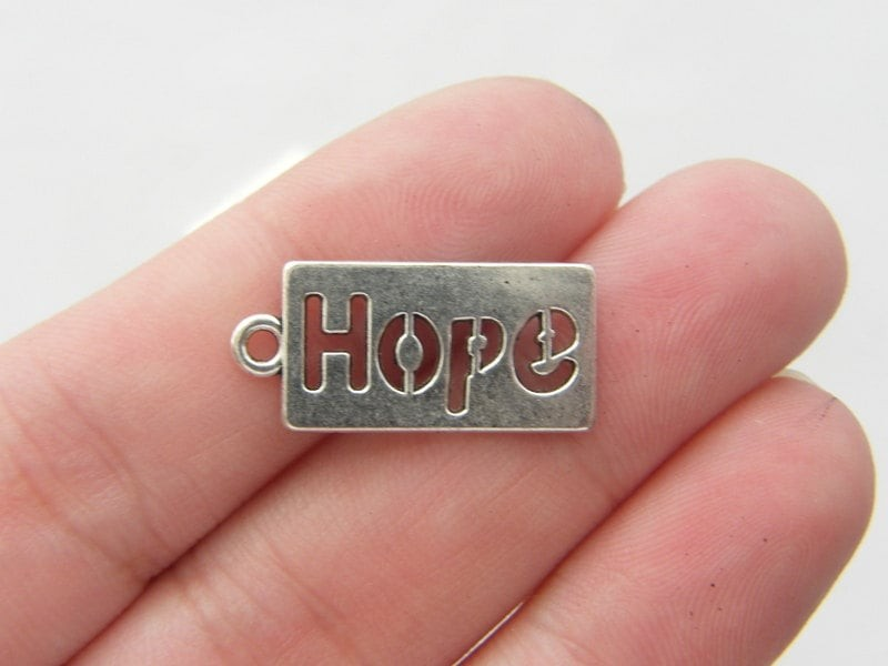 10 Hope charms antique silver tone M116