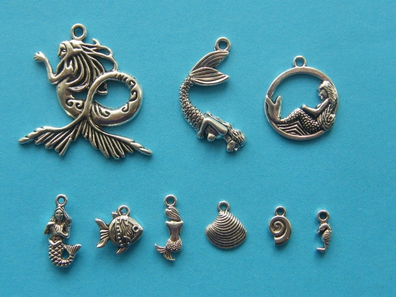 The Big Mermaid Collection - 9 different antique silver tone charms