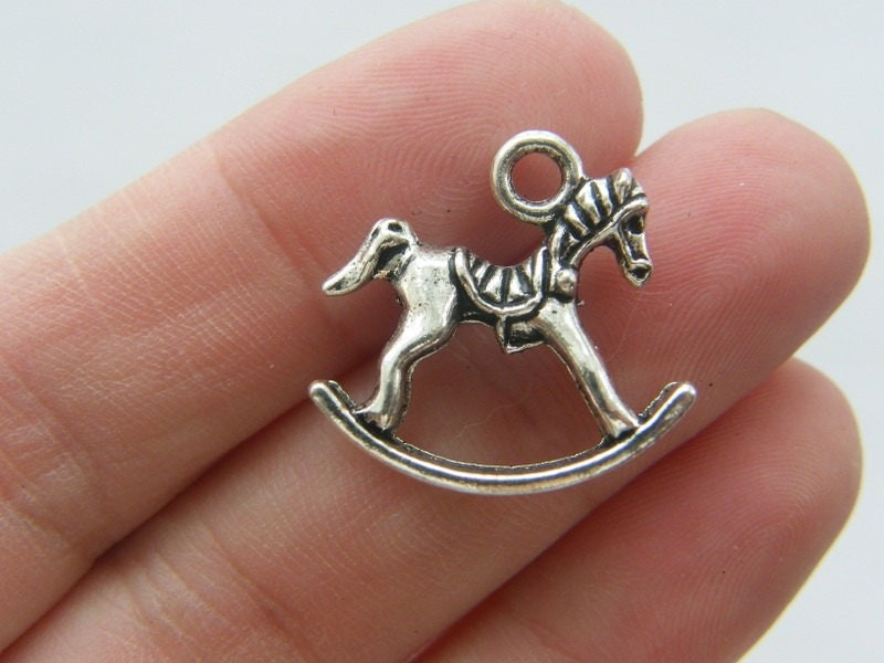 4 Rocking horse charms antique silver tone P614
