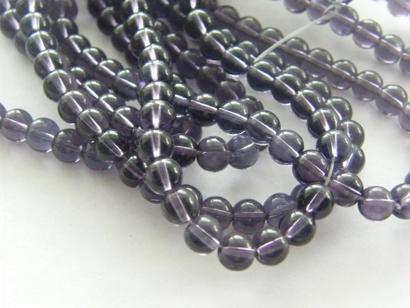 50 Dark purple glass beads B26