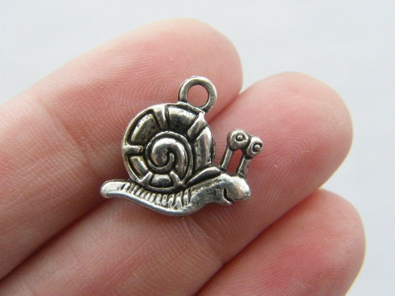 8 Snail charms antique silver tone A244