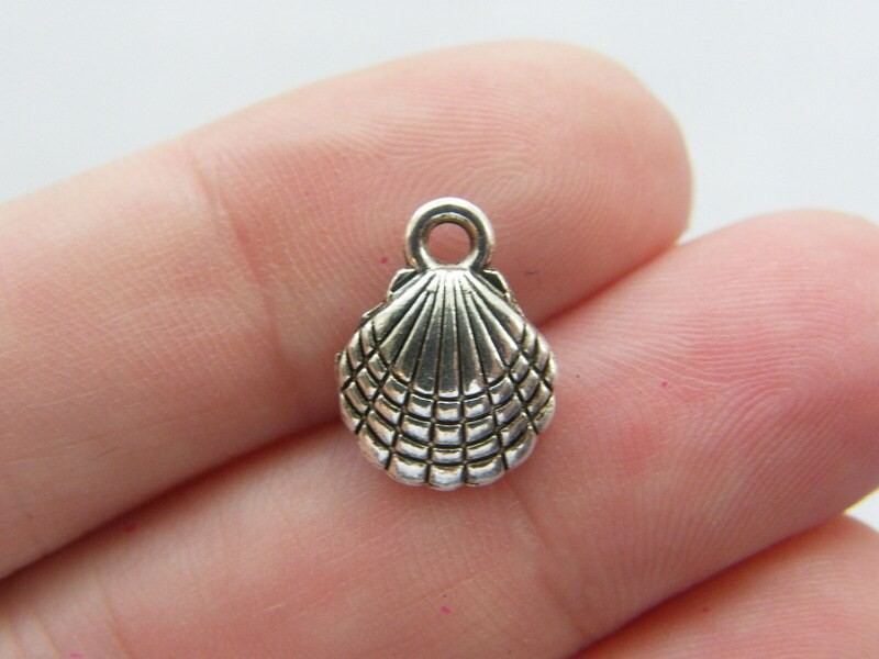 6 Shell charms antique silver tone FF232