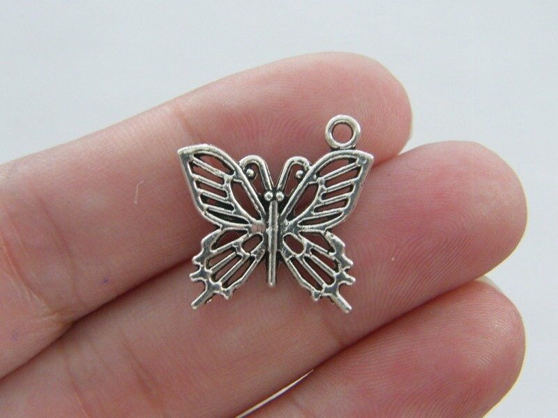 8 Butterfly charms antique silver tone A347